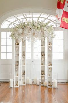 Unique modern altar of bookcases and a floral arch ~ https://www.insideweddings.com/weddings/modern-wedding-with-southern-traditions-in-new-orleans-louisiana/712/