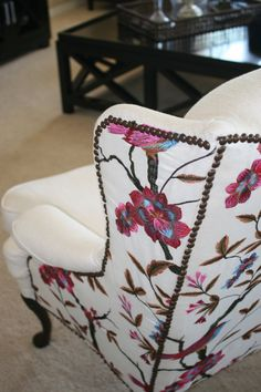 Pattern with nail head trim on back of wing back chair. Cardinal Wing Back Chair via EightyEightFloors // etsy
