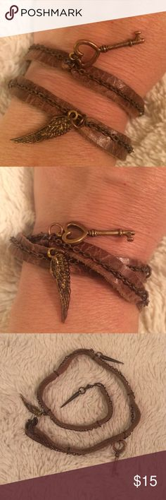 "Brown Leather Wrap Charm Bracelet Approx 15 "" L x 1/4 "" W. leather with chain and charms attached: key, angel wing and 2 spheres. Worn a few times Jewelry Bracelets"