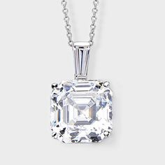 Classic cubic zirconia pendant features a 4.0 carat Asscher-inspired stone accented with a tapered baguette bail. An Italian cable chain is included, with your choice of 16 inch or 18 inch length. This high quality cubic zirconia pendant is set in 14k white gold, also available in 14k yellow gold via special order. Cubic zirconia weights refer to equivalent diamond carat size.