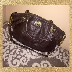 Signature Coach Sophia Bag  This is an authentic signature coach purse. It's a medium sized bag with two small handles and one medium size handle connected to each side. It's a very deep brown metallic color, with a turquoise silk inside. It's very pretty & great for fall/winter seasons! This bag was only used a handful times. The inside is very clean and there is really no signs of use. ✨♥️ Coach Bags Totes