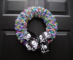 I think I need this for my first Gasparilla back in Tampa-- Large Skull and Crossbones Pirate Wreath by APinkLemonadeDesigns