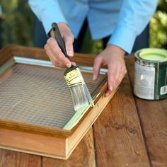 Turn the frame face up. Brush on a coat of outdoor paint to change the color of the frame and offer some protection against the elements. For an antique effect, let the paint dry for a few minutes and then wipe the frame with a clean cloth. If desired, paint the underlying box, too.