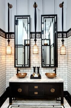art deco bathroom - bathroom mirrors - copper basins - bathroom tiles - black and white - design