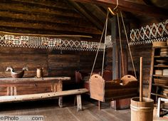 """""""The white chalk paint decoration on the wall is called """"kroting."""" A baby cradle hangs from ropes. On the right is a butter churn made of wood."""" The Hardanger Folk Museum founded in 1911 in Utne, Norway. Casa Viking, Viking House, Viking Life, Medieval Life, Medieval Bed, Annie Sloan Old White, White Chalk Paint, Norse Vikings, Floating"""