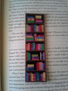 Pattern for Bookshelf Bookmark Cross Stitched For anyone wanting to make a Bookshelf Bookmark for themselves! It's a pretty simple and fun cross stitch project. The pattern includes a jpeg chart/graph and notes on materials used. The colors ar Cross Stitching, Cross Stitch Embroidery, Embroidery Patterns, Hand Embroidery, Cross Stitch Material, Cross Stitch Bookmarks, Cross Stitch Books, Cross Stitch Numbers, Bookmarks To Make