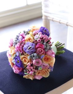 Buttons in bouquet Pretty mixed flower wedding bouquet in bright colours and accessorised with buttons