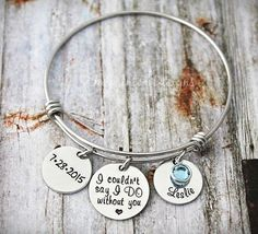This listing includes a wire bangle alex and ani style bracelet. You choose the name, date and birthstone that you would like imprinted. The