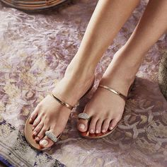 Flat, yes. Boring, never. The RING sandal.