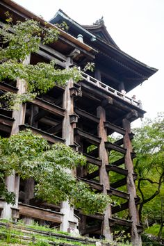 The main hall of the Kiyomizu-dera has a large veranda, supported by tall pillars, that juts out over the hillside and offers impressive views of the city Kyoto.