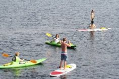 Learn to walk on water with stand-up paddle boarding