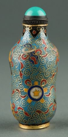 Fine Chinese Cloisonne snuff bottle, of tubular form, richly enamel painted with auspicious objects on turquoise ground