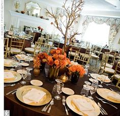 The reception included a lot of metallic decor in the couple's fall color palette. The dinner tables were topped with copper pintuck linens and gold chargers and surrounded by gold chivari chairs.