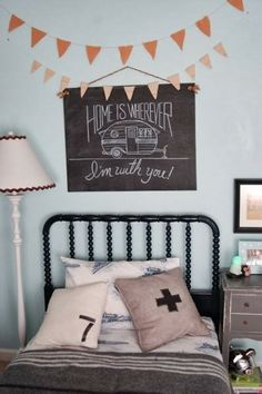 I really love this vintage bed frame and the personal touches - perfect for a childs room