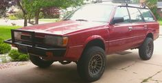 "My beloved. 1992 Subaru Loyale, 4"" lift, 27"" tires, 6 lug hub drill with 14"" aluminum datsun turbine wheels, Just completed EJ22 swap from a 90' Legacy. 4 wheel disc brakes, 15% tinted windows, 5 speed dual range from an 88' GL, new mp3 only stereo, custom exhaust, custom front bumper. Lifted Subaru, Sweet Cars, Car Painting, Cool Cars, Monster Trucks, Offroad, Vehicles, Dreams, Off Road"