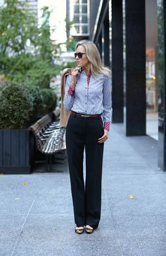 trousers and flats, still looking very professional.