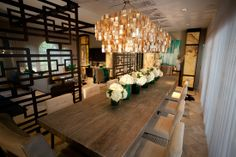 Dining Room | David Bromstad: Love the combination of the reclaimed wood dining table with the golden capiz light fixture (ZGallerie). The size of the table is great for dinner parties. Also love the Asian inspired room divider!.