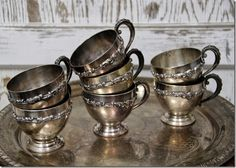 Wonderful tarnished cups and tray..A House Romance