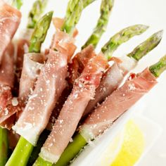 Salted prosciutto wrapped asparagus. Served cold. If you're going to serve it cold, cook the stalks until al dente, then plunge the cooked stalks in an ice water bath to stop the cooking process.