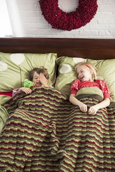 Snuggly Blanket | crochet today--fun holiday colors.  Free pattern via PDF (page says preview but whole pattern is available if you click the PDF link).