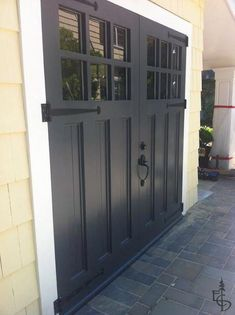 Enemies of carriage doors. Articles about custom swing out carriage house garage doors. Evergreen Carriage Doors builds custom hand crafted authentic antique carriage house doors and carriage garage doors. Carriage Style Garage Doors, Black Garage Doors, Carriage Doors, Painted Garage Doors, Swing Out Garage Doors, Side Hinged Garage Doors, Garage Door Hinges, Pantry Doors, Garage Door Makeover
