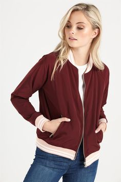 The Retro Sport Bomber is the ultimate must-have this winter. With contrasting varsity stripes on cotton ribbing on the collar, cuffs and waistband and silver hardware, it has an element of sporty chic with a relaxed feminine fit.
