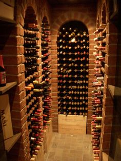 Private wine cellar in Sweden featuring BOXX Wine Racks. Very nice combination of bricks, tiles and wooden wine racks.