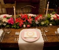 Designed by Event Scene Adelaide.   Pretty place settings with flower garland running the length of the table.