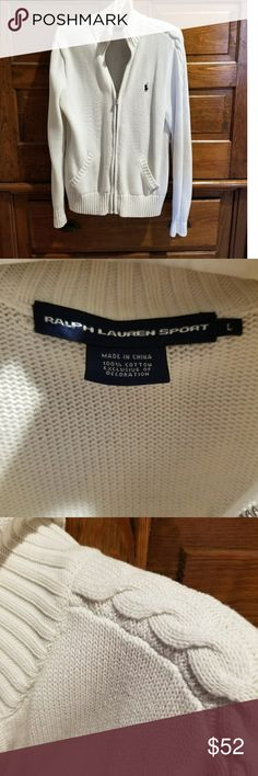 Raulph Lauren Sport zip up cardigan size L Size L RL cardigan in white with navy blue Polo on left side. Beautiful cable knit design in shoulder down to wrist. Worn and washed once.  Amazing quality like new.  Nothing wrong with it.  Please don't hesitate if you need measurements. Thank you and happy Poshing!💞 Polo by Ralph Lauren Sweaters Cardigans