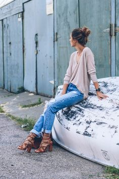 ripped jeans lace up heels and rose gold sweater                                                                                                                                                     More