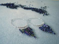 seed-bead-dangle-hoop-earrings-  scroll down thru other patterns to get to this one.
