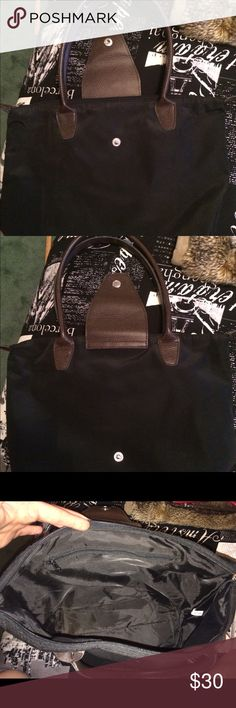 """Guang Tong Purse Black Guang Tong purse with brown handles. Medium size. Barely used, practically new.  Folds up like a Longchamp bag.  The zipper for the inside pocket comes off at the end if you unzip all the way but it's pretty easy to put together again.  Approximately 14.5"""" (L) x 10"""" (H). Guang Tong Bags Shoulder Bags"""