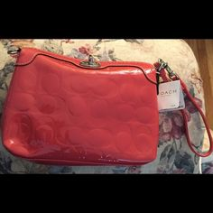 "NWT Coach Shiny Rose Patent Leather Wristlet This is brand new with tags. It's a shiny patent leather in a beautiful rose color. The closer is a silver turn dial. There is a wristlet strap and the Coach name tag. There is no creed in this wristlet, as you will find not every wristlet has one. Size is about 7.75"" x 5.75"". Coach Bags Clutches & Wristlets"