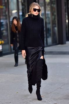 While out in New York, Hadid embraced the all-black look in a Nili Lotan cashmere Aran turtleneck with a silk evening skirt with a slit. - HarpersBAZAAR.com