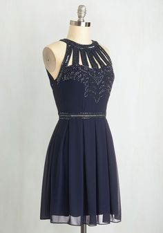 Snowfall Soiree Dress. Everyone knows that glitz and glam are key to stunning seasonal style, and this navy dress offers that and more! #blue #prom #modcloth