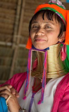 Ban Mae Khao Tom, Chiang Rai Province, Thailand. The Padaung subgroup of the Karen tribe is based mainly in Burma (Myanmar), but some have emigrated to northern Thailand. Within the Padaung, women adorn themselves with neck coils. The practice starts at age 5 or so, with a coil that has a few turns. As a girl matures to adulthood, the original coil is replaced with successively longer ones with additonal turns.