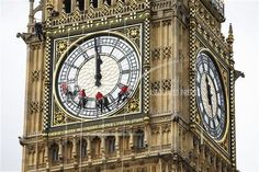 A team of workers cleaning the clock face of Big Ben Abseiling workmen on the clockface of St Stephen's Tower, Houses of Parliament, Westminster, London, Britain - 19 Aug 2014 (Rex Features via AP Images)