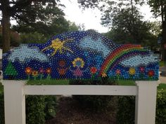 Mural for school garden using recycled plastic caps.  Over 3000 caps!!