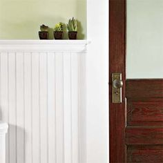New beadboard wainscot in the bath echoes the original ceilings found throughout the rest of the house.