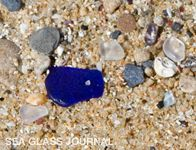 Cobalt blue sea glass is not a rare find on this beach in Old San Juan, Puerto Rico