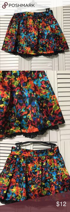 """Steve Madden Skirt Cute multi color silk like (poly) with lining and lace ruffle hem. Zip up back, waist is 13.5"""" length is 15"""" including lace Steve Madden Skirts Mini"""