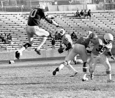 """Tennessee State defensive tackle Ed  """"Too Tall"""" Jones (80) leaps high in the air to block one of the infrequent pass attempts by Alabama State quarterback Don Walker (16), who completed one of just five throws as Jones and the Tigers won a 35-7 decision at W.J. Hale Stadium Nov. 17, 1973."""