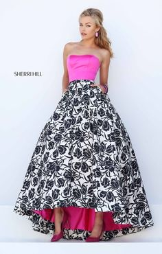 "black and white print ""Audrey length skirt with pink top and peek-a-boo skirt detail Sherri Hill prom dress available at Hope's Bridal"