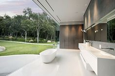 For those who don't mind being part of the scenery, the bathroom in this Montecito home for sale may be appealing. Like the rest of this modern home, the bathroom walls are all glass with views of the surrounding lawn. The listing agent of the Glass Pavilion claims the property is private, but the bathtub's location may test the comfort level of any shy bather.