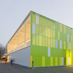 This sports hall in Lelystad, the Netherlands, is coloured in fluorescent shades of green, yellow and blue.