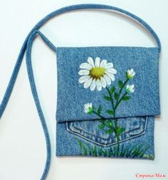 Cute cross body recycled denim bag embroidered with daisy. pocket purse with flap Unavailable Listing on Etsy A beaded Pocket purse that I made from an old pair of Wrang Artisanats Denim, Denim Purse, Jean Purses, Purses And Bags, Jean Pocket Purse, Denim Handbags, Denim Ideas, Denim Crafts, Recycle Jeans
