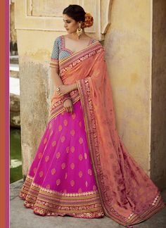 We have largest online collections of lehenga choli. Buy online this sparkling jacquard silk embroidered, patch border and resham work lehenga choli.