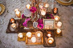 Centerpiece idea, i don't like the color but the picture frames are cute.