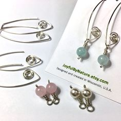 New MODULAR spiral earrings with removable wire-wrapped gemstone charms. Two or more great looks with just one pair of earrings!  •Choose aquamarine, rose quartz, pearl, clear quartz, amethyst or onyx •925 sterling silver •Beautifully packaged for giving