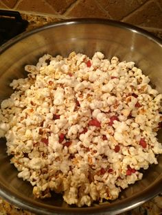 Homemade gourmet popcorn with pancetta, oregano, Parmesan cheese, chili flakes and butter